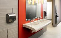 class-A office restroom with red accent wall featuring natural quartz Verge VGD-Series Lavatory System and Diplomat series washroom accessories