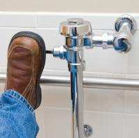 flushing a bathroom toilet with the foot