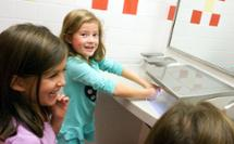 kids drying their hands at 3-in-1 Advocate AV-series sink with co-located soap water and hand drying