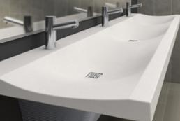 Verge LVS-Series Lavatory system made with gentle curves and Evero Natural Quartz Surface